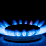 Gas burner blue flames on dark black background