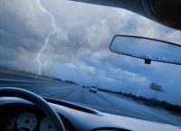 Looking through car windshield into lightning storm